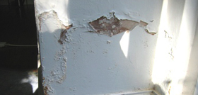 rising damp causing flaking paint and plaster